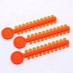 ligadura-elastica-naranja-cristal